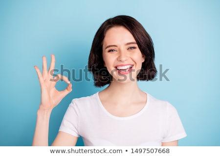 Uśmiechnięta kobieta w porządku gest odizolowany biały kopia przestrzeń Zdjęcia stock © stepstock