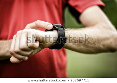 trail runner looking at heart rate monitor watch stock photo © maridav
