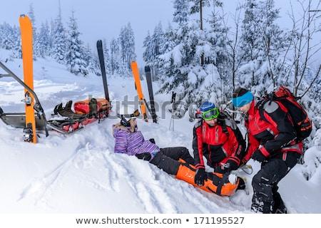 Sauvetage ski aider blessés femme skieur Photo stock © CandyboxPhoto