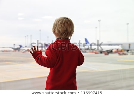 Little boy watching planes at the airport Stock photo © d13