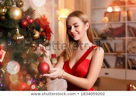 Souriant femme blonde Noël cadeaux hiver vêtements Photo stock © jenbray