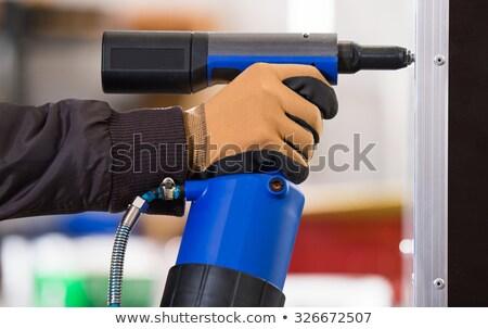 Rzemieślnik nit metal warsztaty powietrza pistolet Zdjęcia stock © Kzenon