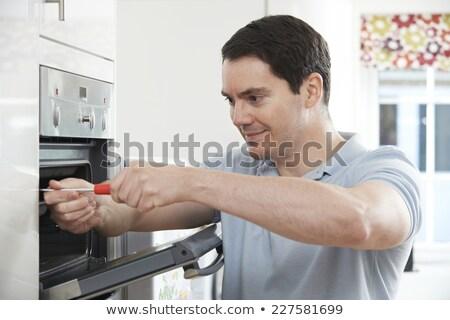 электрик · печи · отвертка · молодые · мужчины - Сток-фото © highwaystarz