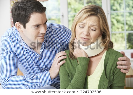 Foto d'archivio: Husband Comforting Wife Suffering With Neck Injury