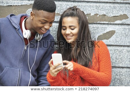Teenager Couple Sharing Text Message On Mobile Phone Stock photo © HighwayStarz