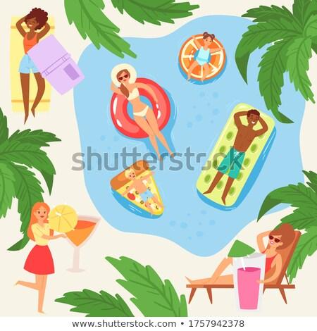 Menino sessão praia colchão pequeno verde Foto stock © nyul