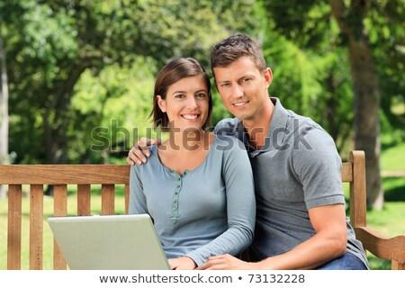 mutlu · dizüstü · bilgisayar · kullanıyorsanız · çim · bilgisayar · sevmek - stok fotoğraf © deandrobot