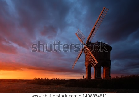 Moulin à vent coucher du soleil Photo stock © chrisga