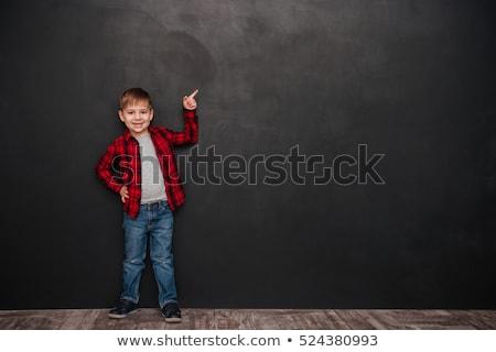 erkek · işaret · beyaz · gülümseme · çocuk · tek · başına - stok fotoğraf © konradbak