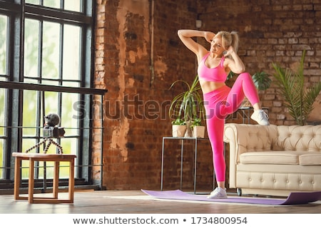woman doing abs exercise with coach stock photo © deandrobot