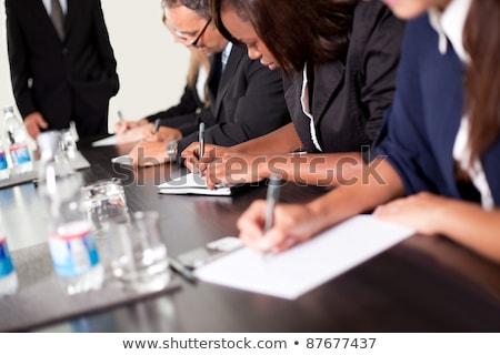 üzletemberek · jegyzetel · csoport · megbeszélés · nő · iroda - stock fotó © wavebreak_media