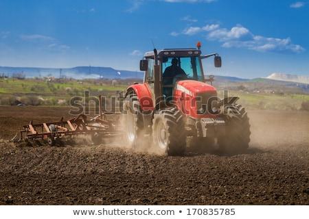 veld · agrarisch · machines · Rood · trekker · hemel - stockfoto © jordanrusev