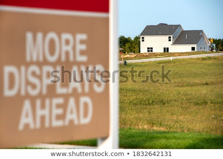 sold lot sign at new home construction site stock photo © feverpitch