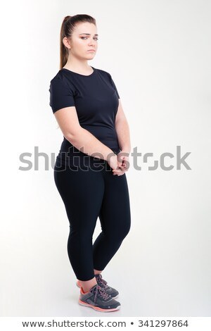 Portrait of a fat sad woman in sportswear  Stock photo © deandrobot