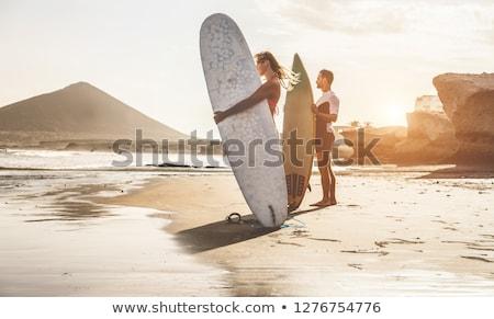 Sörfçü çift gün batımı örnek kız adam Stok fotoğraf © adrenalina