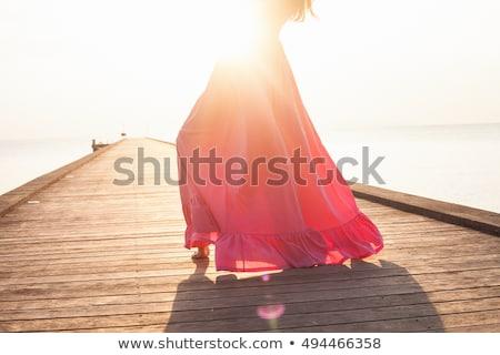 красивая · девушка · позируют · балкона · очаровательный · девушки - Сток-фото © deandrobot