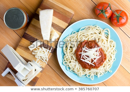 Pasta press next to gruyere cheese and noodles Stock photo © ozgur