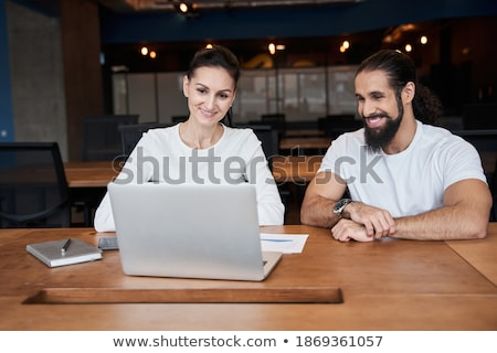 portrait of brunette woman with tablet looking at her colleague stock photo © d13