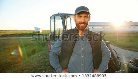 Retrato feliz homem jeans condução trator Foto stock © diego_cervo