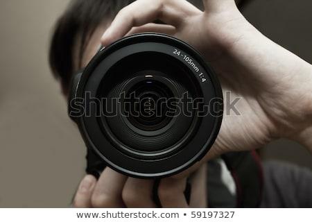 close up of male photographer with digital camera Stock photo © dolgachov