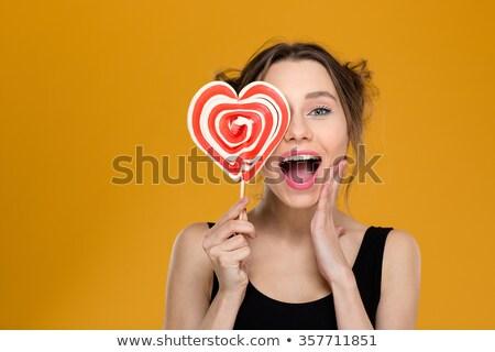 Encantador mulher olho pirulito retrato Foto stock © deandrobot