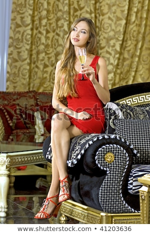 rich woman on a red expensive sofa Stock photo © ssuaphoto