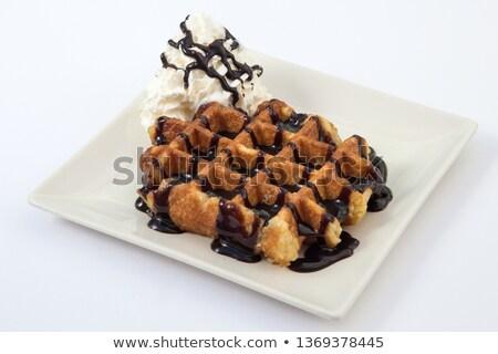 chocolate belgian waffles stacked on white stock photo © luissantos84