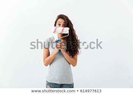 Funny woman hiding her face with brush and paint roller Stock photo © deandrobot