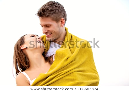Happy young couple wrapped in blanket at beach Stock photo © wavebreak_media