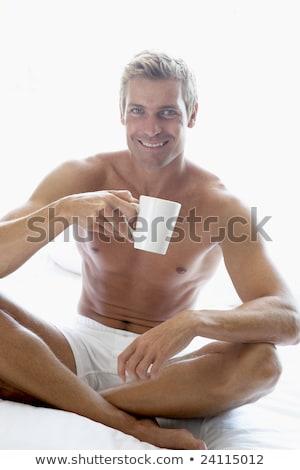 Сток-фото: взрослый · человека · сидят · кровать · питьевой · домой