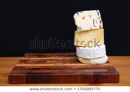 Delicious Swiss yellow cheese on dark wooden rustic background closeup Stock photo © yelenayemchuk