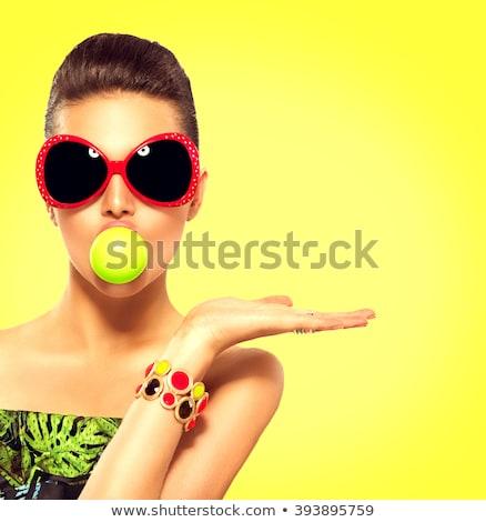 Gyönyörű nő napszemüveg tart kézmozdulat pop art retro Stock fotó © studiostoks