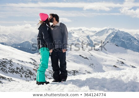 skiers kissing on top of mountain stock photo © is2
