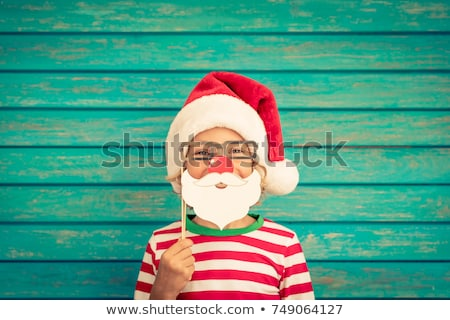 kid with santa hat and fake beard Stock photo © LightFieldStudios