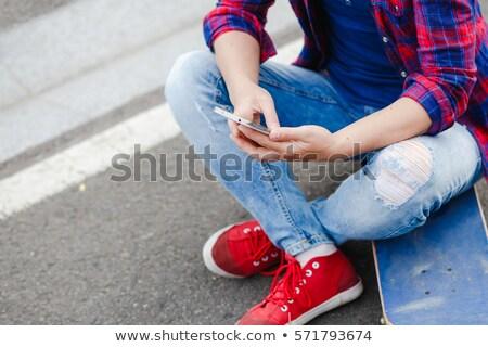 Patinador menina telefone falante celular sapatos Foto stock © keeweeboy