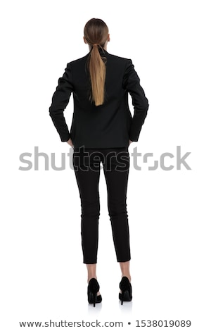 business woman standing with hands in pockets and smiles stock photo © feedough
