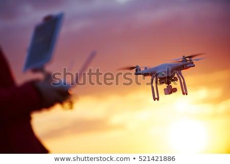 Quadrocopter in flight at sunset Stock photo © Fotografiche