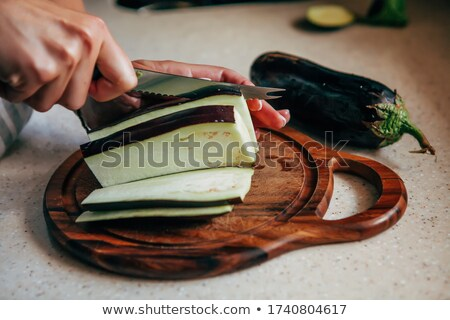 A chef cutting an Aubergine Stock photo © IS2