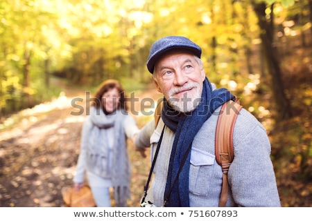 old man and old woman holding hands Stock photo © nito