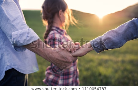 Grandad holding granddaughter's hand Stock photo © IS2