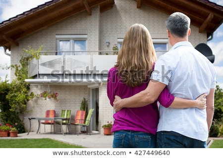 beautiful mature couple in front of their house stock photo © hannamonika