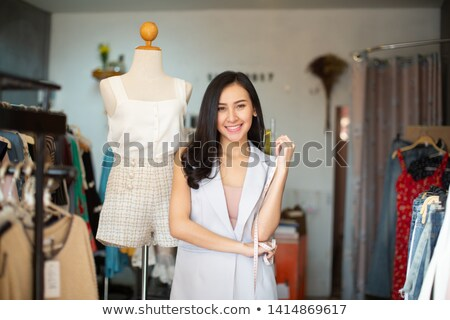 Lovely young woman clothes designer Stock photo © deandrobot