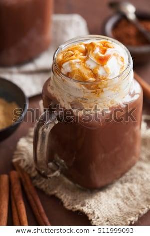 Kubek bita śmietana karmel szkła jar Zdjęcia stock © dash