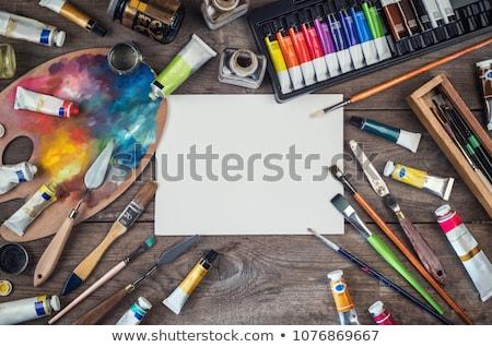 palette knife, brushes and paint tubes on table Stock photo © dolgachov