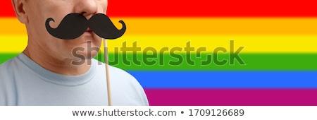 közelkép · pár · homoszexuális · büszkeség · szivárvány · szalagok - stock fotó © dolgachov