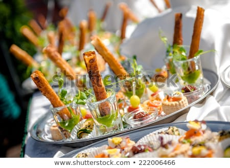 Delicious snacks on wedding reception table in luxury outdoor restaurant stock photo © ruslanshramko