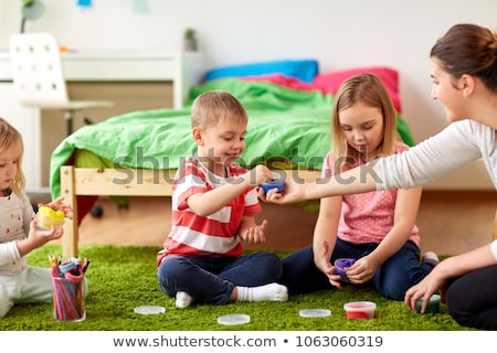 kids and mother with modelling clay or slimes Stock photo © dolgachov