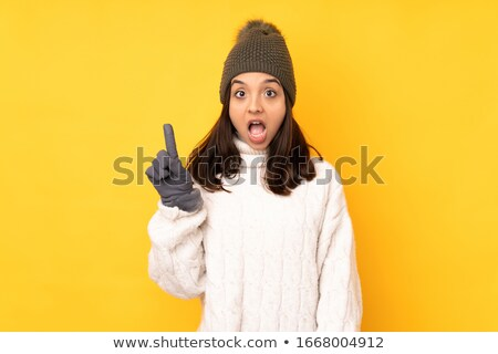 confused young woman wearing christmas hat stock photo © deandrobot