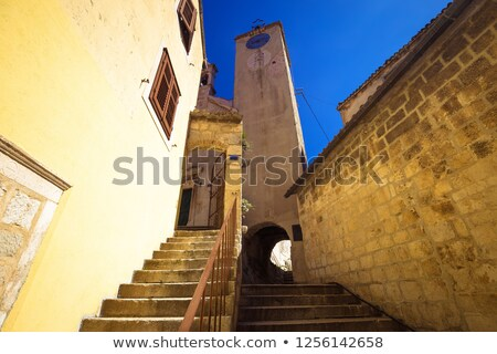old stone carved street and tower of omis old town stock photo © xbrchx