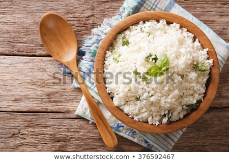 Couve-flor arroz temperos tigela cinza Foto stock © YuliyaGontar